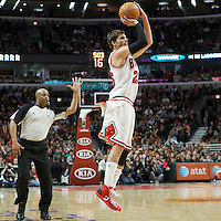 10 March 2012: Chicago Bulls shooting guard Kyle Korver (26) takes a three points jumpshot during the Chicago Bulls 111-97 victory over the Utah Jazz at the United Center, Chicago, Illinois, USA.