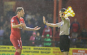 Jake Hyde remonstrates with the assistant during the Sky Bet League 2 match between York City and Yeovil Town at Bootham Crescent, York, England on 18 August 2015. Photo by Simon Davies.