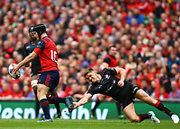 Rugby Union - 2016 / 2017 European Rugby Champions Cup - Semi-Final: Munster vs. Saracens<br /> <br /> Owen Farrell of Saracens tackles Munster's Tyler Bleyendaal  at the Aviva Stadium, Dublin.<br /> <br /> COLORSPORT/KEN SUTTON