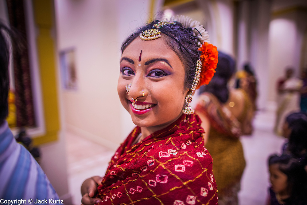 10 AUGUST 2012 - PHOENIX, AZ:   A woman waits to dance during the celebration of Janmashtami at Ekta Mandir, a Hindu temple in central Phoenix. Janmashtami is the Hindu holy day that celebrates the birth of Lord Krishna. Hindu communities around the world celebrate the holy day. In Arizona, most of the Hindu temples in the Phoenix area have special celebrations of the day.  PHOTO BY JACK KURTZ