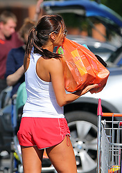 Newlywed Melanie Sykes looking mighty tanned wearing a white vest top and a pair of red shorts out shopping at Sainsbury's. The very toned TV presenter had no problem pushing a full trolley load of shopping and off loading the bags in the boot of her car... London, UK. 04/06/2013<br />