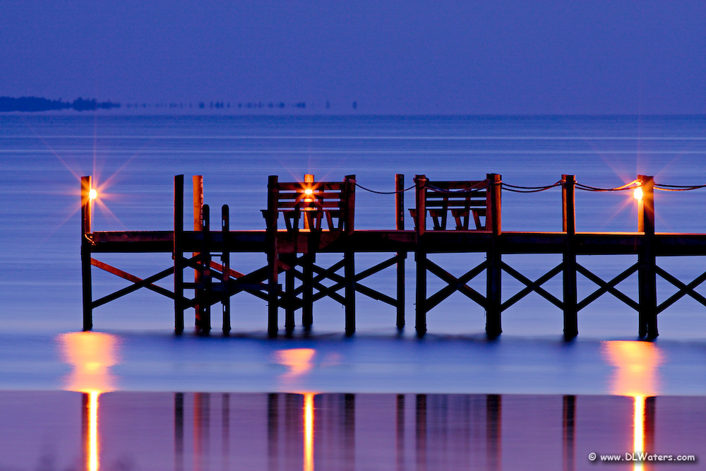 A pier behind  Jockey's Ridge State Park in Nag Head NC photographed at twilight.