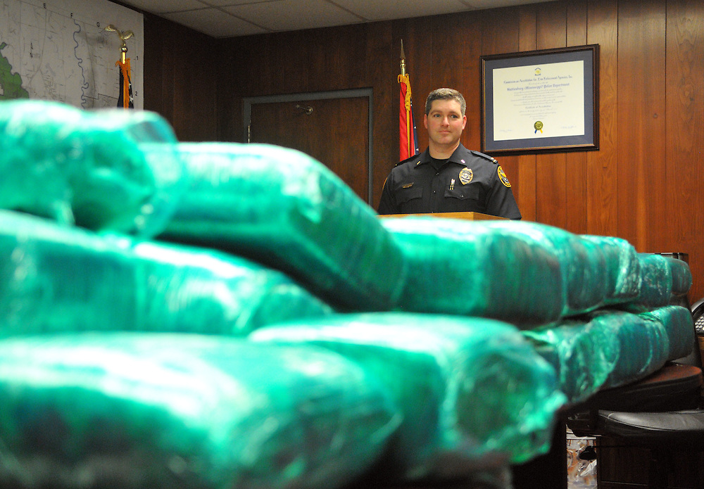 Lt. Eric Proulx of the Hattiesburg Police Department stands in front of 626 pounds of marijuana valued at $500,800 that was obtained during a traffic stop by an officer on HPD's interdiction team at about one a.m. Monday morning on interstate 59 near the 63 mile marker. The driver, Deano Simpson, and the passenger, Natascia Buchanan, were charged with possession of marijuana over a kilo with the intent to distribute and were taken to the Forrest County jail. Bryant Hawkins/Hattiesburg American
