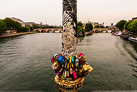 Symbols of undying love, padlocks (whose keys are thrown in the Seine River) are attached to the Pont des Arts (bridge), Paris, France.