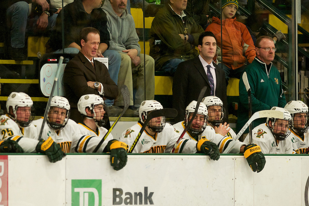 Catamounts head coach Kevin Sneddon watches the action on the ice during the mens hockey game between the Boston Terriers and the Vermont Catamounts at Gutterson Field House on Friday night Novemebr 16, 2012 in Burlington, Vermont.
