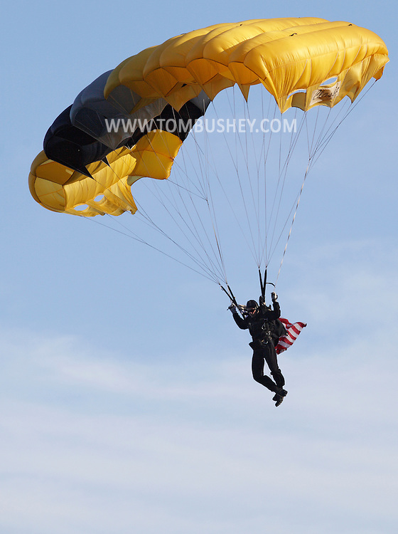 West Point, NY - A member of the Black Knights West Point Parachute Team jumps onto the field at the Anderson Rugby Center before Army plays Navy in a rugby match at the United States Military Academy on Nov. 21, 2009. ©Tom Bushey / The Image Works