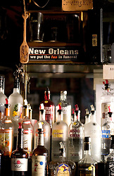 10 Sept 2005. New Orleans,  Louisiana. Hurricane Katrina aftermath.<br /> The Irony of a sign that hangs behind the bar at Molly's  bar on Decatur Street, the famous French Quarter that bar remained open throughout the days following the storm.<br /> Photo; ©Charlie Varley/varleypix.com