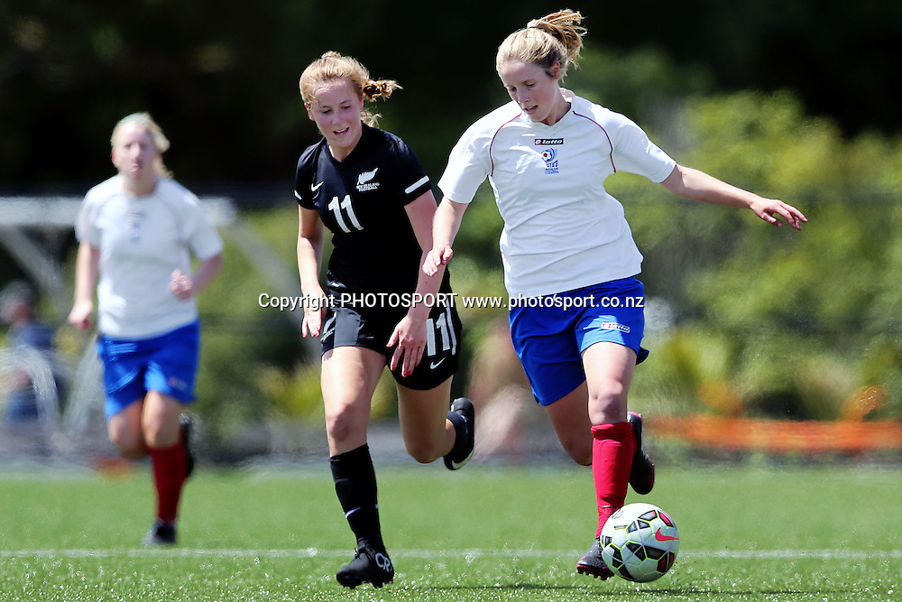 Sam Muirhead of Auckland Football competes against Emily Oosterhof of NZF Development . 2014 ASB Women's League football match, Auckland Football v NZF Development at William Green Domain, Auckland, New Zealand. Sunday 23 November 2014. Photo: Anthony Au-Yeung / photosport.co.nz
