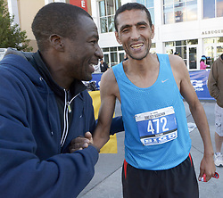 October 21, 2018 - U.S. - SPORTS -- Duke City Men's Marathon winner Rachid Kisri is congratulated by Mbarak Hussein after posting a time of 2:25.59 on Sunday, October 21. (Credit Image: © Greg Sorber/Albuquerque Journal via ZUMA Wire)