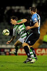 Yeovil Town's James Hayter is pressured by Wycombe Wanderers' captain, Dave Winfield - Photo mandatory by-line: Dougie Allward/JMP  - Tel: Mobile:07966 386802 04/12/2012 - SPORT - FOOTBALL - Johnstone's Paint Trophy  -  Yeovil  -  Huish Park  -  Yeovil Town V Wycombe Wanderers