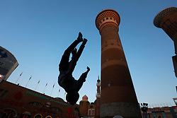 An ethnic Uighur boy performs parkour moves at the Dabazha or Grand Bazaar in Urumqi city, Xinjiang Uighur Autonomous Province, China, 18 November 2017. Uighurs, a Muslim ethnic minority group in China, make up about 40 per cent of the 21.8 million people in Xinjiang, a vast, ethnically divided region that borders Pakistan, Afghanistan, Kazakhstan, Kyrgyzstan and Mongolia. Other ethnic minorities living in here include the Han Chinese, Kyrgyz, Mongolian and Tajiks people. Xinjiang has long been subjected to separatists unrests and violent terrorist attacks blamed by authorities on Islamist extremism while human rights groups say Chinese repression on religious rights, culture and freedom of movement caused undue tensions. Life however goes on under the watchful eye of the government for the ethnic Uighurs living in the city of Urumqi and surrounding areas and the region is still considered an attractive tourist spot. A recent report by state media Xinhua news agency claims Xinjiang received more than 100 million tourists in 2017, 'the highest figure in its history'.