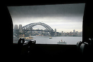 Sydney Harbour bridge seen from a suburban train.