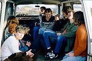 Group of teens in a van, UK, 1980s.