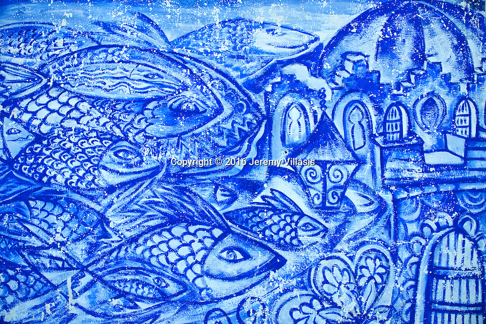 Mural along Moulay Hassan Ben Mahdi in Asilah, depicting the town's colors (blue and white) and main livelihood (fishing).
