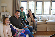 The Baker family in their living room. From left to right: Liza Baker (9), Steve Baker, Zac Baker (11), Susannah Baker. Pickwell Manor, Georgeham, North Devon, UK.<br /> CREDIT: Vanessa Berberian for The Wall Street Journal<br /> HOUSESHARE