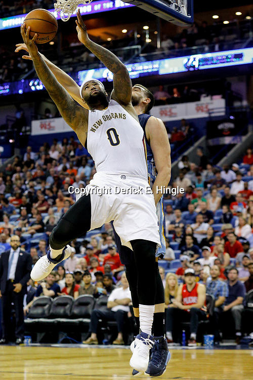 Mar 21, 2017; New Orleans, LA, USA; New Orleans Pelicans forward DeMarcus Cousins (0) shoots over Memphis Grizzlies center Marc Gasol (33) during the second half of a game at the Smoothie King Center. The Pelicans defeated the Grizzlies 95-82. Mandatory Credit: Derick E. Hingle-USA TODAY Sports