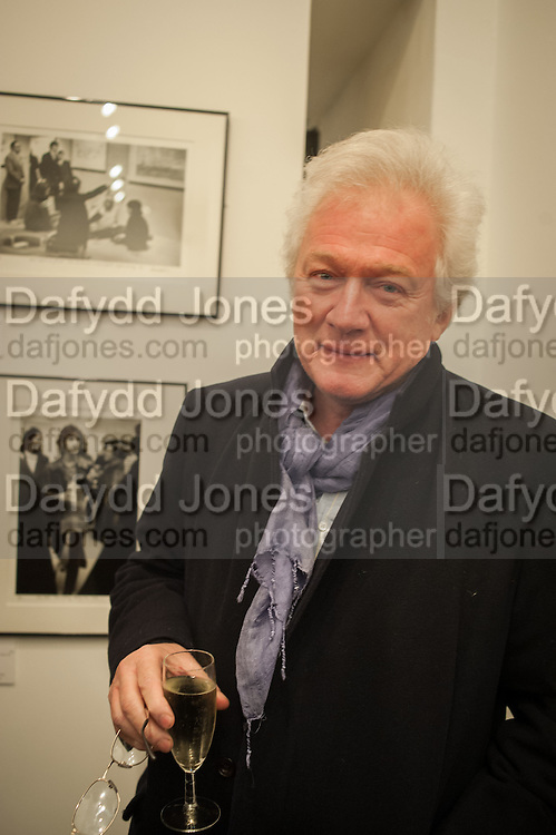 HOMER SYKES, Ossie Clark: The King of The King's Road Reigns Again . Mixed exhibition of photographs of Ossie Clark inc pictures by Terry O Neill, Homer Sykes and Neil Libbert, Proud Chelsea, King's Rd. London. 20 February 2013.