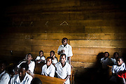 A boy stands up to answer his teacher's question at the Mboga primary school in the town of Kibati, on the outskirts of Goma, Eastern Democratic Republic of Congo on Friday December 12, 2008. Classes started again on Dec 1 after the school was occupied during 8 weeks by IDPs fleeing fighting.