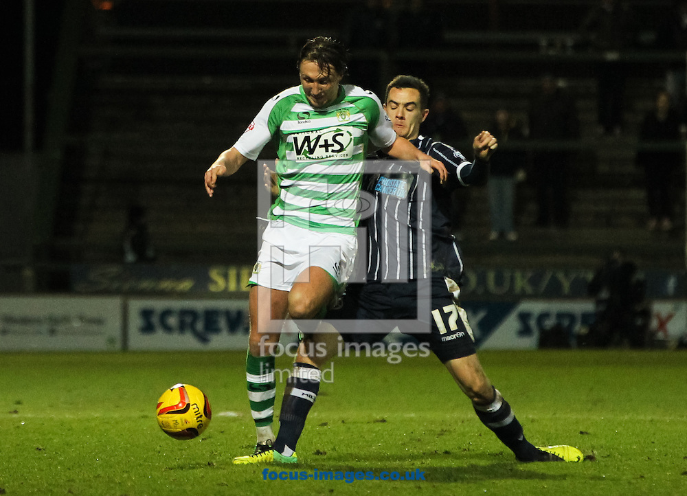 Luke Ayling (left) of Yeovil Town gets tackled by Shaun Williams (right) of Millwall during the Sky Bet Championship match at Huish Park, Yeovil<br /> Picture by Tom Smith/Focus Images Ltd 07545141164<br /> 11/02/2014