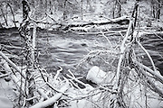 Raging water and snow on the Patapsco River in Oella, Maryland.