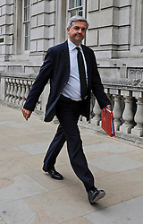 © licensed to London News Pictures. File picture dated 17/05/2011. Chris Huhne Whitehall London. 03/02/2012 Chris Huhne today learns whether he will be charged in relation to allegations that he and his ex-wife, Vicky Pryce, conspired to pervert the course of justice in relation to a speeding incident. It has been alleged that Mr Huhne asked Miss Pryce, then his wife, to take his penalty points following the incident, which took place in March 2003. If charged then it is believed Mr Huhne will have to step down from his cabinet post: Photo credit : Stephen Simpson/LNP