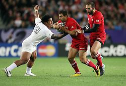 Georgia's David Kacharava, centre, fends off England's Manu Tuilagi in the Rugby World Cup pool match at Otago Stadium, Dunedin, New Zealand, Sunday, September 18, 2011. Credit:SNPA / Dianne Manson.