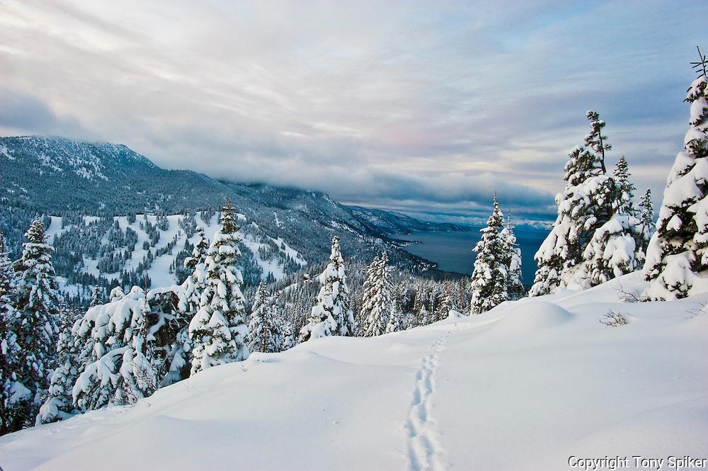"""Winter Sunrise Over Lake Tahoe 2"" - The sun rises over Lake Tahoe and the ski resprt of Diamond Peak."