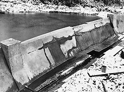 © Licensed to London News Pictures. 21/03/2006 Watford, UK. A 50th scale model of The Möhne Dam at the Building Research Establishment, Watford, Herts photographed in 1941. The model was the first piece in the jigsaw which led to the successful Dambusters raid on the night of May 16th, 1943. Records in BRE's archive show that in late 1940, William Glanville of the Road Research Laboratory brought Barnes Wallis to a secret meeting with Dr Norman Davey at the site near Watford. At the meeting, Wallis' plans to attack the Mohne and Eder dams were outlined and it was decided that the most effective way to determine the weight of explosive and optimum location to detonate it was to construct and test a scale model. Norman Davey built the model at BRE in 1941 and work began testing by staff of the Road Research Laboratory, under Dr A Collins. The model dam's discovery was published as the final shots for the film The Dambusters were being recorded, and the very first tests at BRE were not reported in the film classic..Photo credit : BRE Archive/LNP