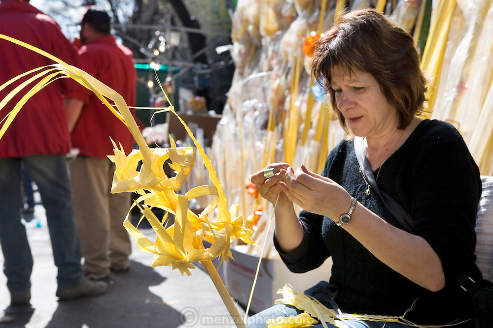 A woman making Palm Sunday ornaments out of palm fronds, Barcelona, Spain.