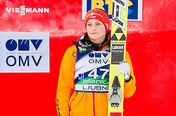 Third placed Carina Vogt of Germany celebrates during flower ceremony after the 11th Women FIS Ski Jumping World Cup competition in Planica replacing Ljubno  on January 25, 2014 at HS95, Planica, Slovenia. Photo by Vid Ponikvar / Sportida