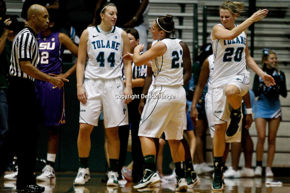November 19, 2011; New Orleans, LA; Tulane Green Wave Danielle Blagg (20) celebrates with teammates guard Jamie Kaplan (23) and center Brett Benzio (44) after hitting the winning shot during overtime of a game against the LSU Lady Tigers at Avron B. Fogelman Arena. Tulane defeated LSU 65-62 in overtime. Mandatory Credit: Derick E. Hingle-US PRESSWIRE