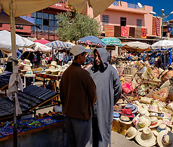 Two men chatting in a market square, Marrakech, Morocco, North Africa<br /> <br /> (c) Andrew Wilson | Edinburgh Elite media