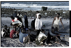 Fuerteveuntura, Canary Islands, Spain.Sub-Saharan immigrants rest, after they arrived by boat from Morocco, in the Spanish Canary Island of Fuerteventura, Spain. Thousands of African immigrants try to make the journey to Europe each year as illegal migrants looking for a better life.©Carmen Secanella