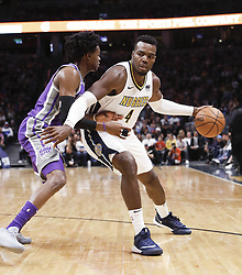 October 21, 2017 - Denver, Colorado, U.S - Nuggets PAUL MILSAP, right, goes in to the paint with Kings DE'AARON FOX, left, during the 1st. Half at the Pepsi Center Saturday night. The Nuggets beat the Kings 96-79. (Credit Image: © Hector Acevedo via ZUMA Wire)