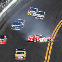 Sprint Cup Series driver Juan Pablo Montoya (42) spins out of turn 4 during the Daytona 500 at Daytona International Speedway on February 20, 2011 in Daytona Beach, Florida. (AP Photo/Alex Menendez)