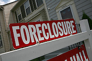 A foreclosure sign in front of a home in Manassas, VA . Photograph by Dennis Brack
