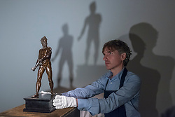 "© Licensed to London News Pictures. 29/06/2018. LONDON, UK. A staff member presents ""The Dresden Mars"" by Giambologna (Est. £3-5m).  Preview of Old Masters, British, Treasures, Sculptures and Ancient works at Sotheby's New Bond Street to be offered for sale on 3 and 4 July 2018.  Photo credit: Stephen Chung/LNP"