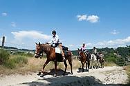 Camino de Santiago (Chemin de Saint Jacques) from Le Puy-en-Veley, Haute Loire, France. Pictured, horse riders on the trail near Aumont-Aubrac. © Rudolf Abraham