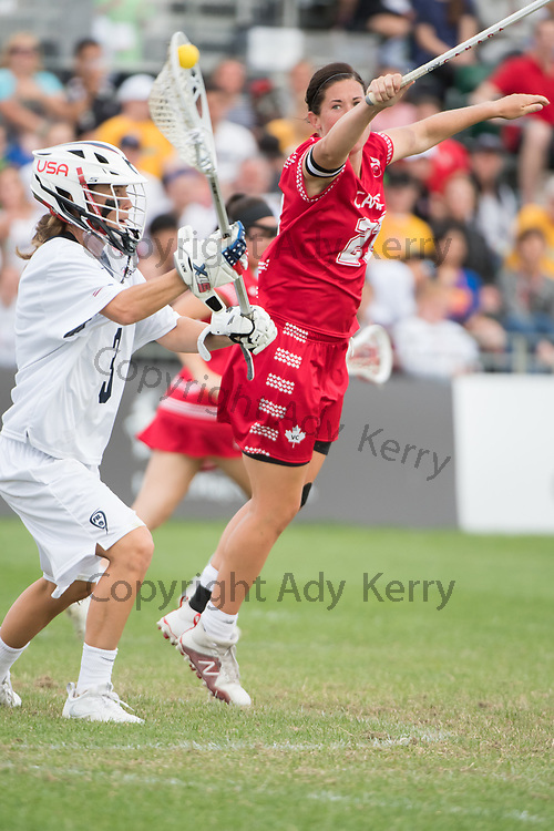 Canada's Dana Dobbie tries to block Devon Wills' pass at the 2017 FIL Rathbones Women's Lacrosse World Cup at Surrey Sports Park, Guilford, Surrey, UK, 15th July 2017