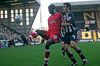 Photo: Pete Lorence.<br />Notts County v Swindon Town. Coca Cola League 2. 23/09/2006.<br />Fola Onibuje flicks the ball away from Mike Edwards of Notts County.