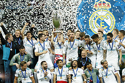 (L-R) Jesus Vallejo of Real Madrid, goalkeeper Kiko Casilla of Real Madrid, Marcos Llorente of Real Madrid, Karim Benzema of Real Madrid, Nacho of Real Madrid, Daniel Carvajal of Real Madrid, Raphael Varane of Real Madrid, Gareth Bale of Real Madrid, Luka Modric of Real Madrid, Achraf Hakimi of Real Madrid, Sergio Ramos of Real Madrid with UEFA Champions League trophy, Coupe des clubs Champions Europeens, Marcelo of Real Madrid, goalkeeper Luca Zidane of Real Madrid, Lucas Vazquez of Real Madrid, goalkeeper Keylor Navas of Real Madrid, Mateo Kovacic of Real Madrid, Marco Asensio of Real Madrid, Theo Hernandez of Real Madrid, Toni Kroos of Real Madrid, Isco of Real Madrid, Casemiro of Real Madrid, Dani Ceballos of Real Madrid during the UEFA Champions League final between Real Madrid and Liverpool on May 26, 2018 at NSC Olimpiyskiy Stadium in Kyiv, Ukraine