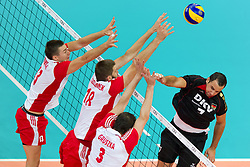 10.09.2011, O2 Arena, Prag, CZE, Europameisterschaft Volleyball Maenner, Vorrunde D, Deutschland (GER) vs Polen (POL), im Bild Michal Kubiak (#13 POL), Marcin Mozdzonek (#18 POL), Piotr Gruszka (#3 POL) - Georg Grozer (#7 GER / Rzeszow POL) // during the 2011 CEV European Championship, Germany vs Poland at O2 Arena, Prague, 2011-09-10. EXPA Pictures © 2011, PhotoCredit: EXPA/ nph/  Kurth       ****** out of GER / CRO  / BEL ******