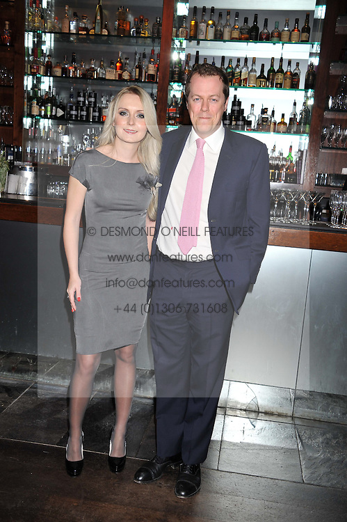 TOM PARKER BOWLES and OLGA GERASIMOVA co-founder of Pomp Magazine, at a party to celebrate the launch of Pomp magazine - a magazine representing London Luxury without the Ceremony focusing on the luxury, fashion and culture of the Capital, hosted by Tom Parker Bowles and the Directors of Pomp Magazine held at The Cuckoo Club, Swallow Street, London on 17th November 2011.