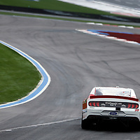 Ryan Reed (16) races through the field off turn two at the Federated Auto Parts 400 at Richmond Raceway in Richmond, Virginia.