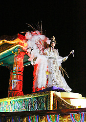 29 January 2016. New Orleans, Louisiana.<br /> Queen of the parade - Myra F Cancienne takes her place at the head of the Krewe of Cleopatra, kicking off the main parading season of Mardi Gras in New Orleans with floats filled with riders dispensing beads and throws, marching bands and dance troupes. Families line the streets Uptown to cheer on Cleopatra - 'Throw me something Mister!'<br /> Photo©; Charlie Varley/varleypix.com