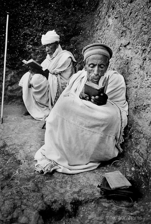 Ethiopian Orthodox pilgrims at Lalibela, Ethiopia. Monks in private prayer during the festival of Timkat (Epiphany). Lalibela in northern Ethiopia is famous for it's monolithic roack hewn churches and is one Ethiopia's holiest cities and a centre of pilgrimage for much of the country.Lalibela in northern Ethiopia is famous for it's monolithic roack hewn churches and is one Ethiopia's holiest cities and a centre of pilgrimage for much of the country.