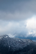 Clouds clearing off a summit in the white mountains