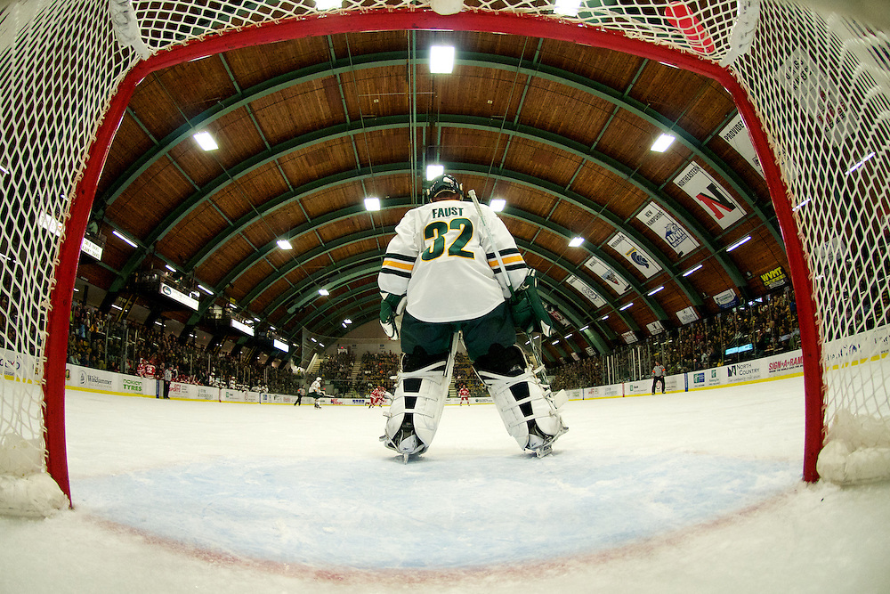 Catamount goalie Billy Faust (32) in action during the mens hockey game between the Boston Terriers and the Vermont Catamounts at Gutterson Field House on Friday night Novemebr 16, 2012 in Burlington, Vermont.
