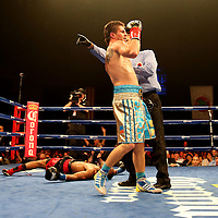 Ievgin Khytrov from Ukraine (blue trunks) fights against Chris Chatman of California during the Iron Mike Productions,  ESPN Friday Night Fights boxing match at Turning Stone Resort Casino on Friday, June 6, 2014 in Verona, New York.  (AP Photo/Alex Menendez)