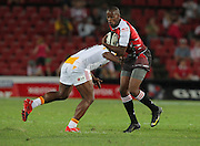 JOHANNESBURG, South Africa, 19 February 2010. Wandile Mjekevu of the Lions is tackled by Sitiveni Sivivatu of the Chiefs during the Super 14 match between the Lions and the Chiefs at Coca-Cola Park in Johannesburg, South Africa on 19 February 2010.<br /> Photographer : Anton de Villiers / SPORTZPICS
